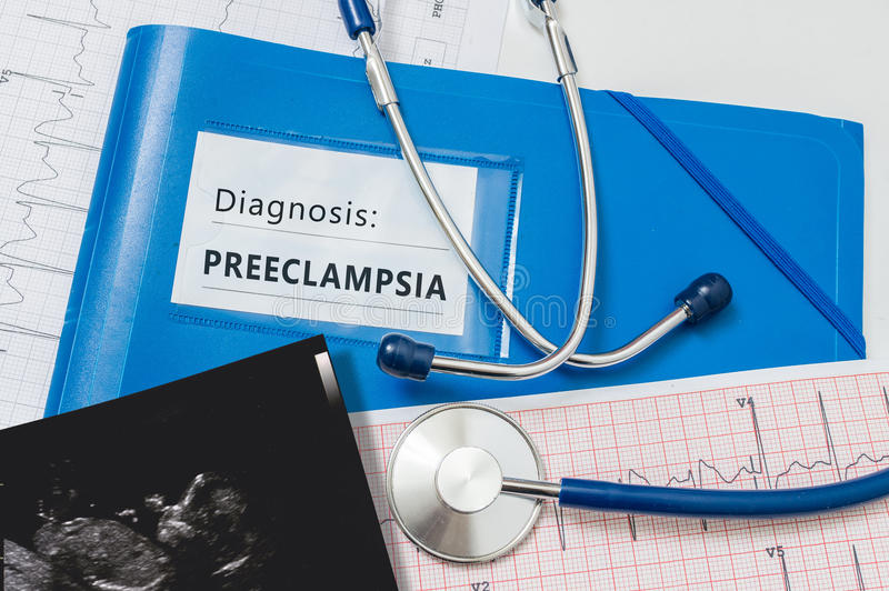Preeclampsia diagnosis for pregnant patient with risky pregnancy.  stock images