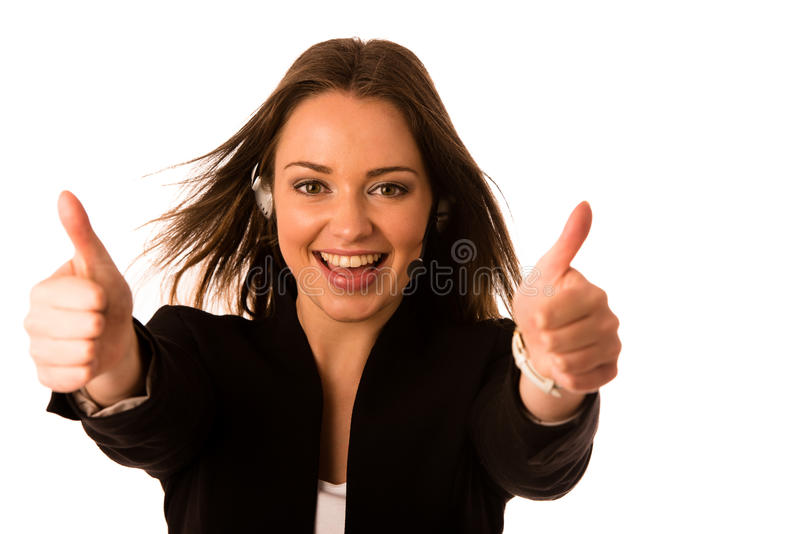 Preety happy asian caucasian business woman with headset showing. Thumb up as a gesture for success isolated stock photography