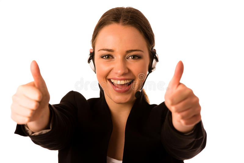 Preety happy asian caucasian business woman with headset showing. Thumb up as a gesture for success isolated stock images