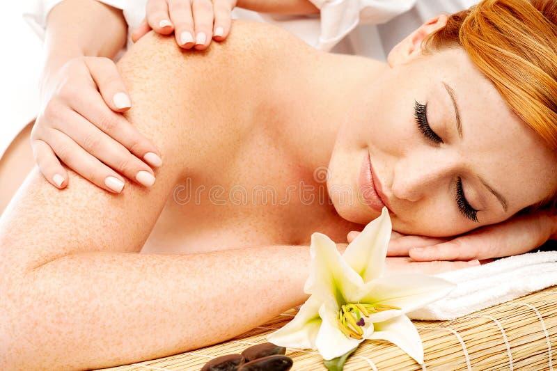 Preety woman in spa treatment. Beautiful woman having a wellness back massage stock photography