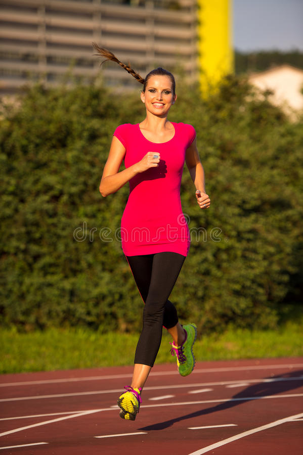 Free Preety Young Woman Running On A Track Stock Image - 45721461