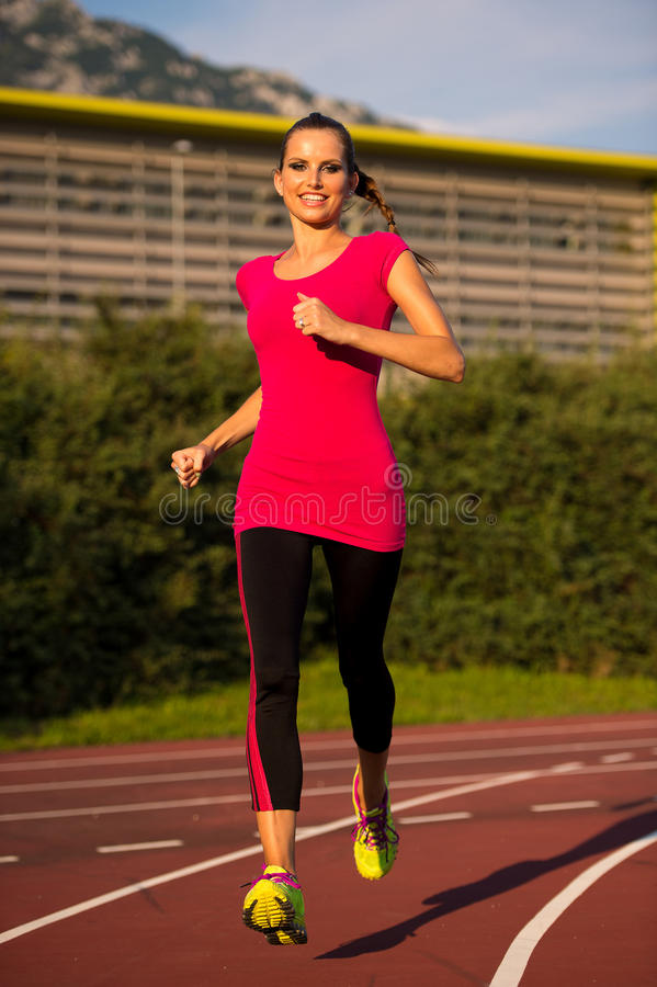 Free Preety Young Woman Running On A Track Stock Images - 46042364