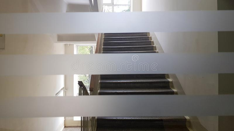 Prefabricated house building interior with entrance hall and staircase. Precast concrete staircase. Staircases adorn the building. Beautiful long staircase stock photo