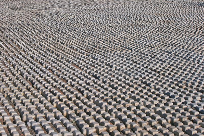 PREFABRICATED SURFACE IN PARKING AREA. View of slabs of prefabricated concrete surface laid down on the ground in a parking area royalty free stock photo