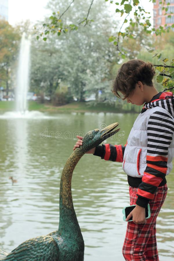 Preference for nature. A teenage girl has an interest in wildlife, rather than modern gadgets royalty free stock image
