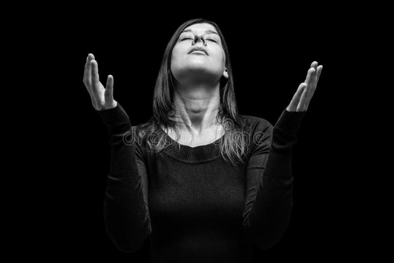 Pregare di dolore della donna fotografia stock libera da diritti