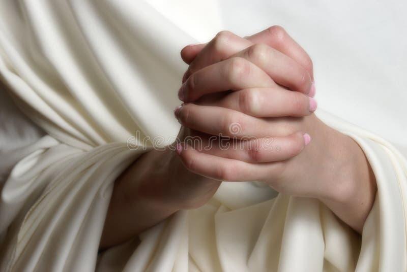 Pregare le mani immagini stock