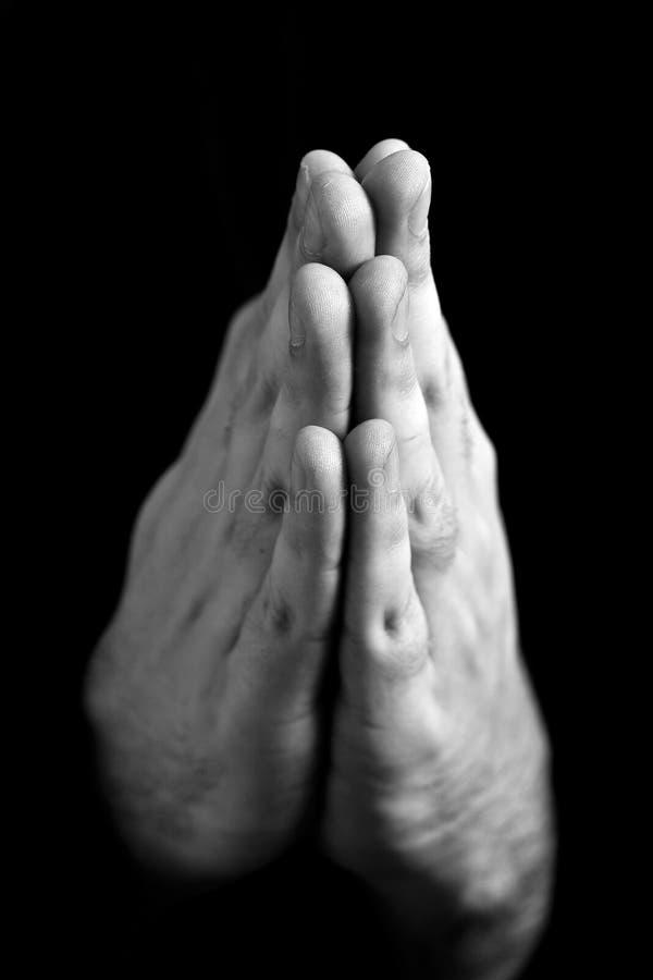 Preghiera dell'uomo (DOF poco profondo) immagine stock libera da diritti