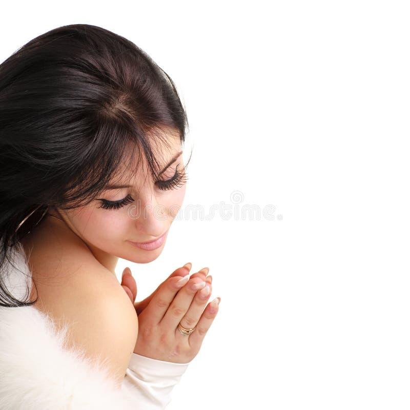 Preghiera della giovane donna immagine stock