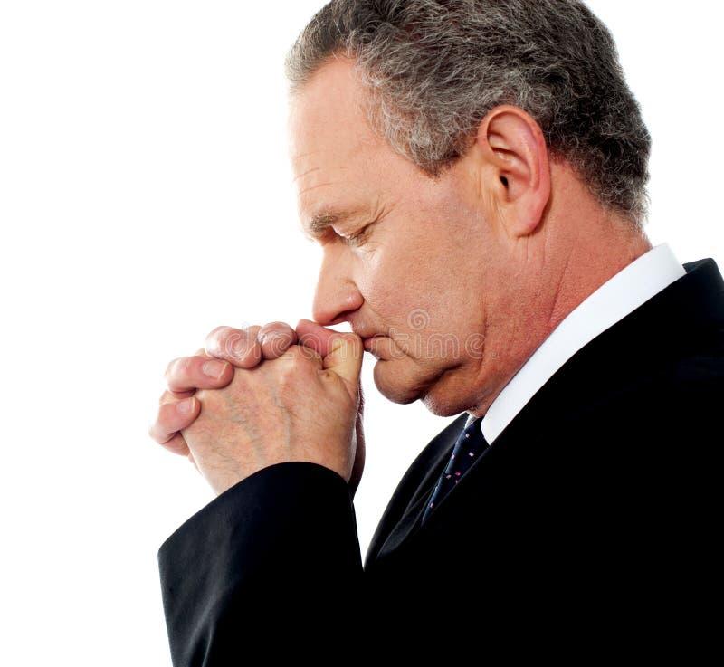Preghiera della persona di affari immagine stock