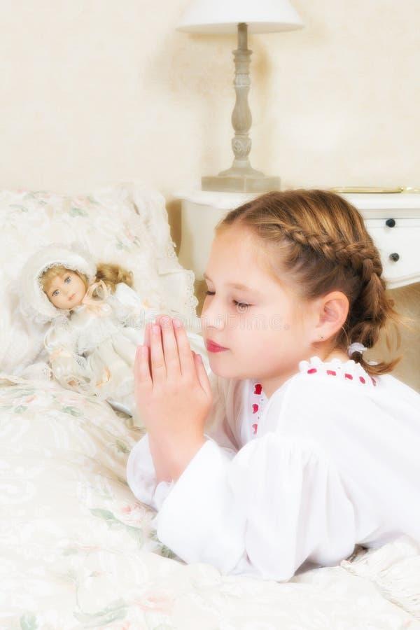 Preghiera della ragazza dell'annata fotografia stock