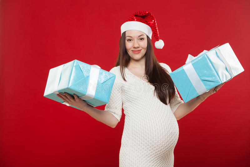 Pregnancy Christmas on a red background royalty free stock image