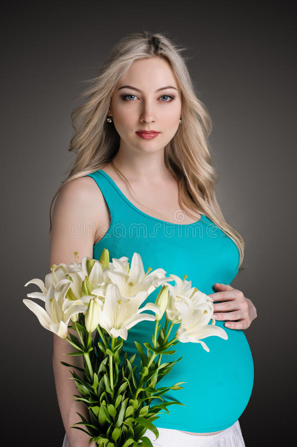 Pregnancy with flowers royalty free stock photo