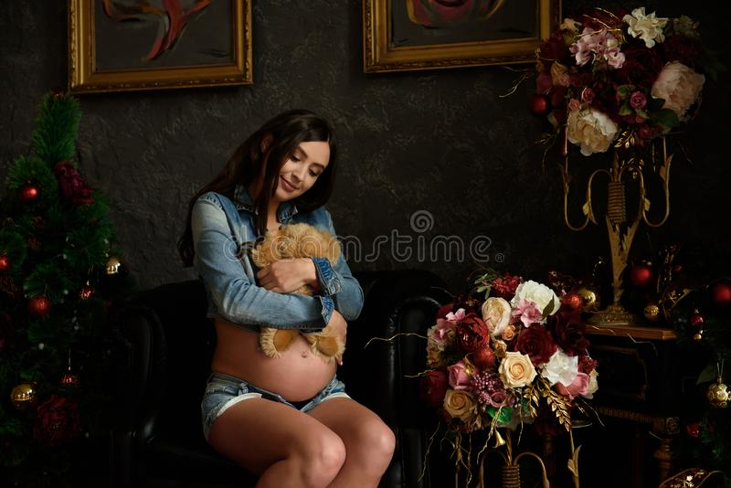 Pregnancy, motherhood, people and expectation concept - close up. Of happy pregnant woman with big belly royalty free stock images