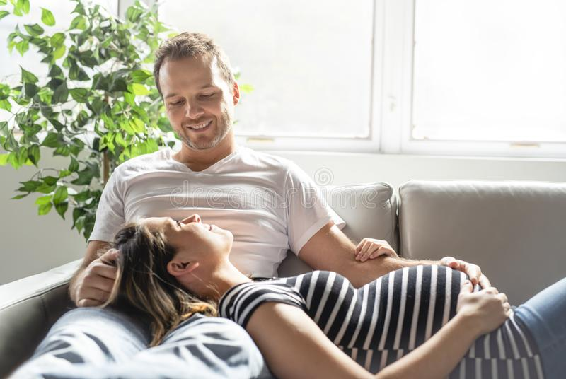 A pregnancy and people concept happy man pregnant woman at home stock photos