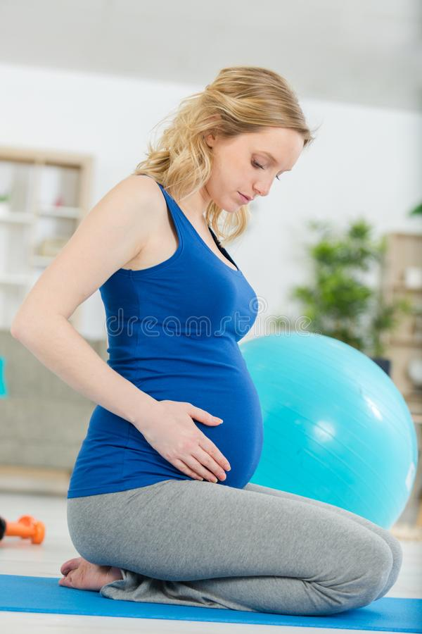 Pregnancy rest people and expectation concept. Woman stock photo