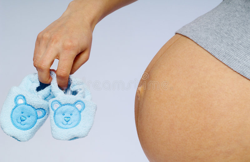 Pregnancy & shoes royalty free stock image