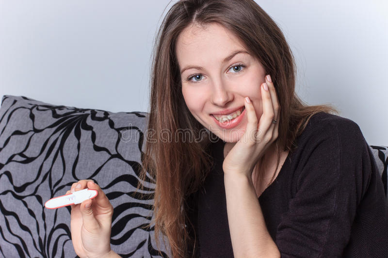 Pregnancy test positive result smiling woman stock photos