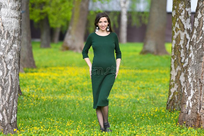 Pregnancy in warm weather. Happy pregnancy and motherhood concept. Young pregnant woman enjoying the fresh air and warm weather. Outside royalty free stock images