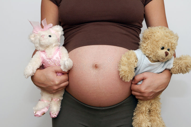 Pregnant belly - boy or girl? stock photography