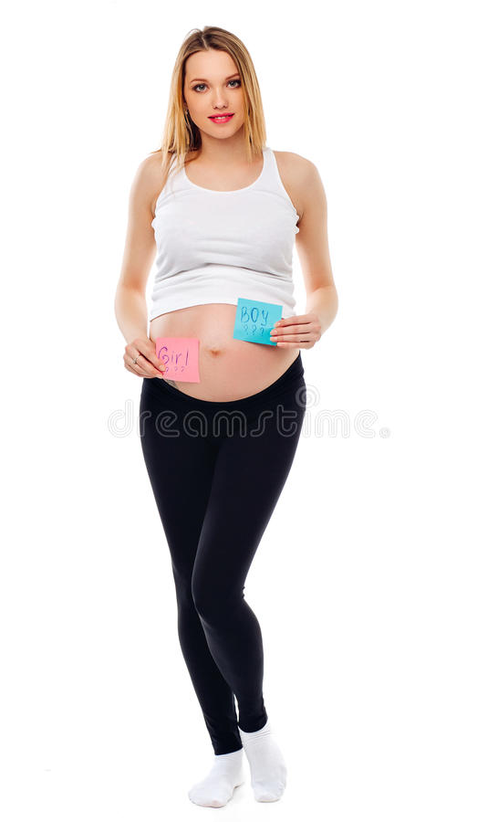Pregnant belly boy and girl pictures on stickers, woman expecting baby, family and parenting concept. young pregnant royalty free stock image