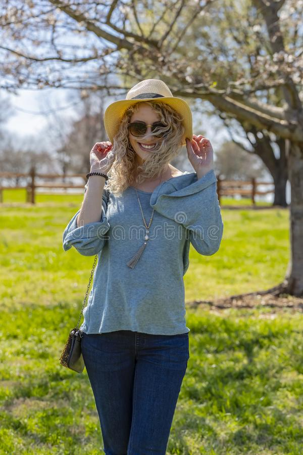 Pregnant Blonde Model At A Local Park stock photos