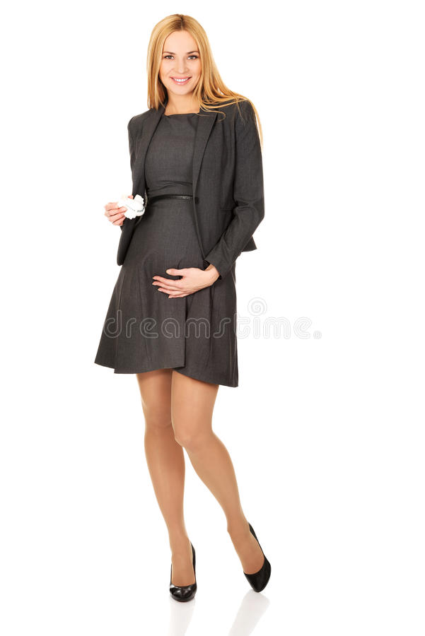 Pregnant businesswoman holding plane model stock image