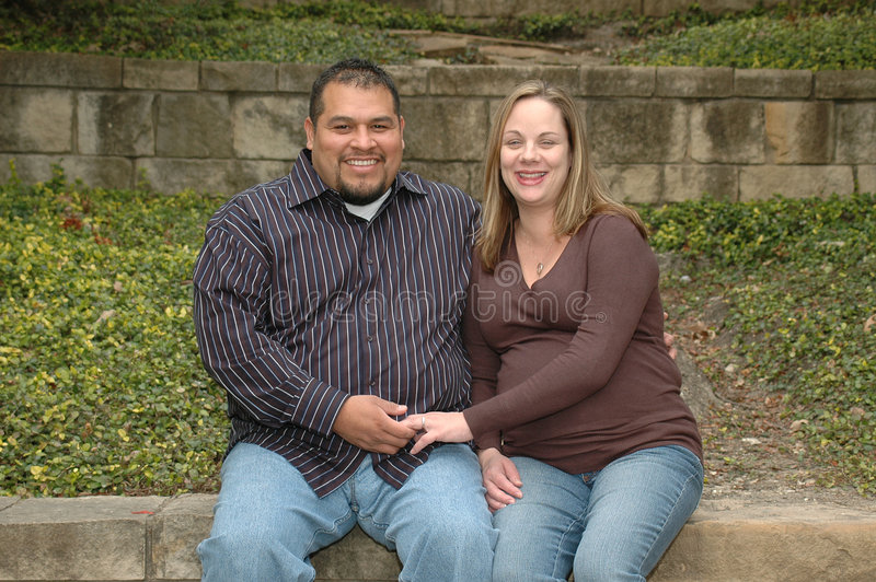 Pregnant Couple. Diverse mixed couple having a baby