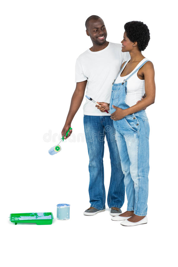 Pregnant couple with blue paint tin royalty free stock images