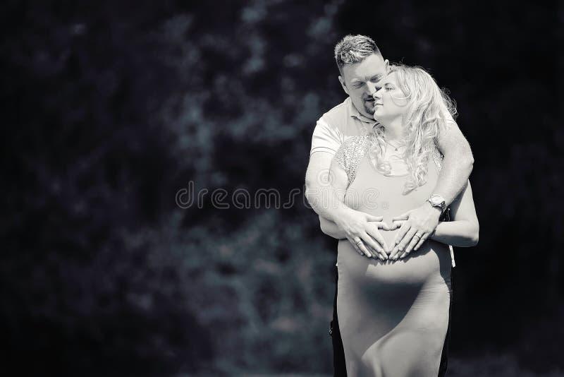 Pregnant couple maternity heart stock photos
