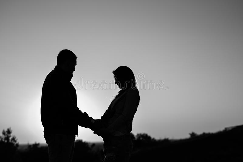 Pregnant couple silhouettes royalty free stock images