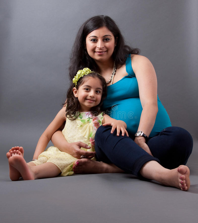 Pregnant East Indian Woman with her Daughter royalty free stock photos