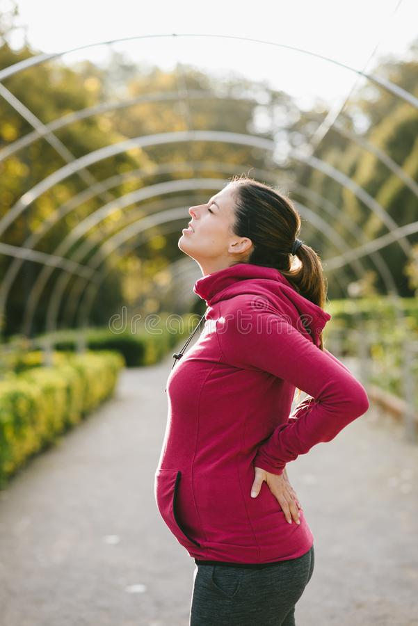 Pregnancy lower back pain stock image