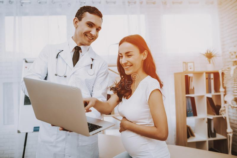 Pregnant Girl at the Gynecologist Doctor stock photo