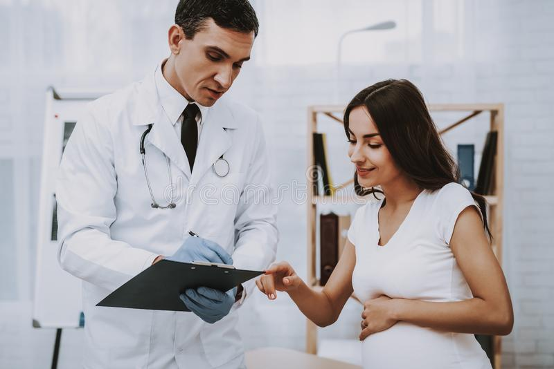 Pregnant Girl at the Gynecologist Doctor royalty free stock image