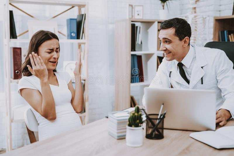 Pregnant Girl at the Gynecologist Doctor royalty free stock photo