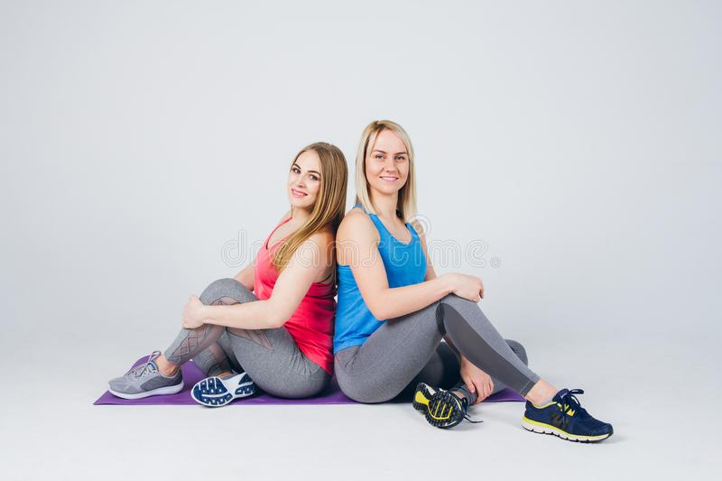 Pregnant girl and her friend are engaged in fitness royalty free stock images