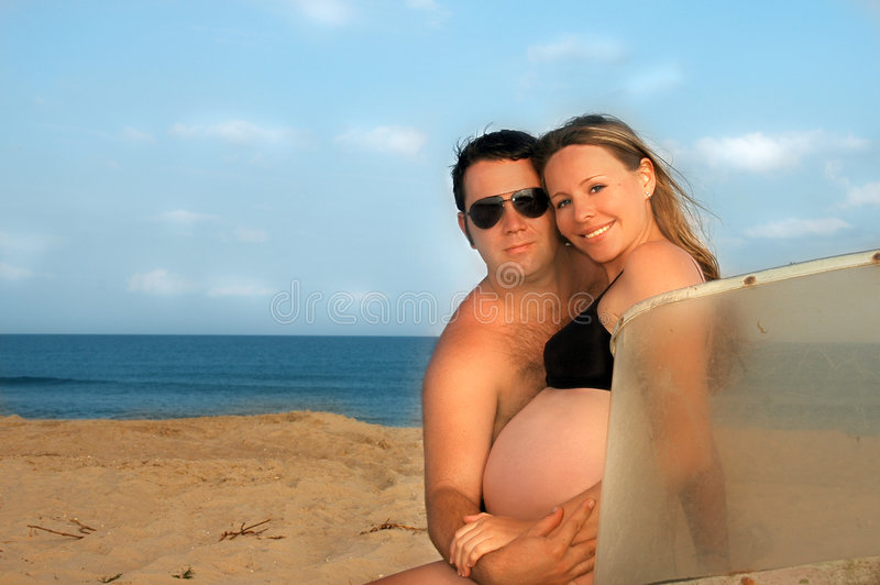 A pregnant girl with her husband stock photos