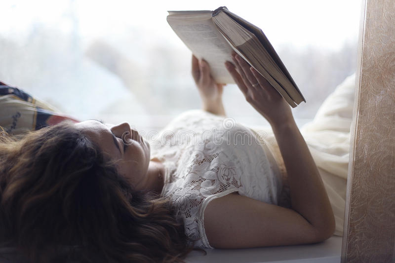 Pregnant girl reading stock photography