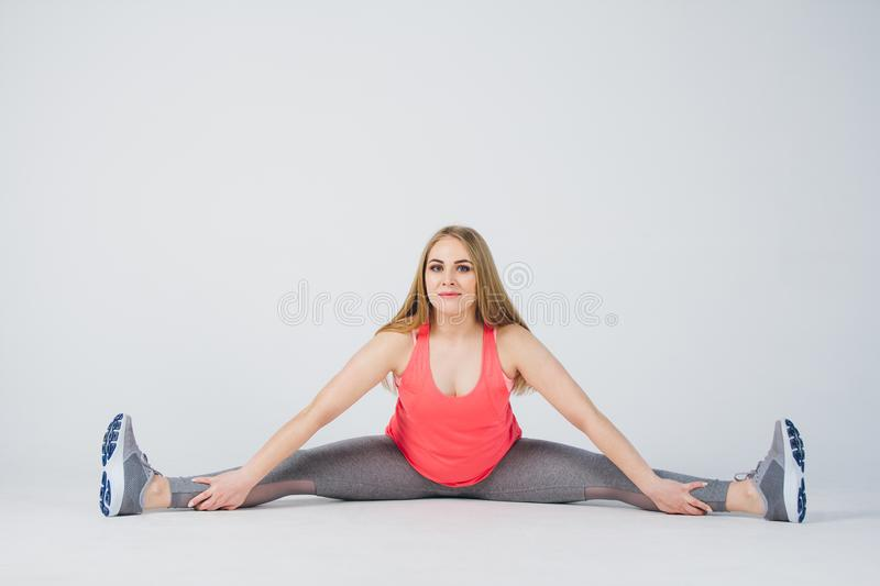Pregnant girl in sportswear is engaged in fitness royalty free stock image
