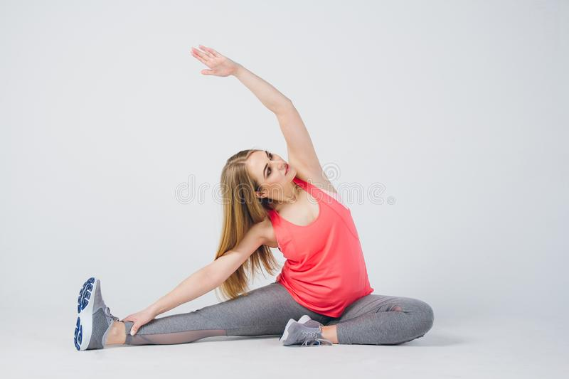 Pregnant girl in sportswear is engaged in fitness royalty free stock photos