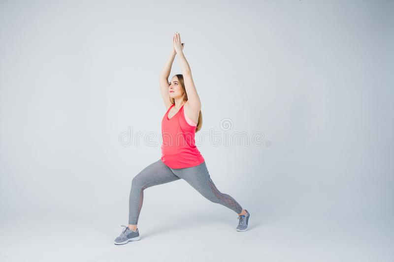 Pregnant girl in sportswear is engaged in fitness stock photos