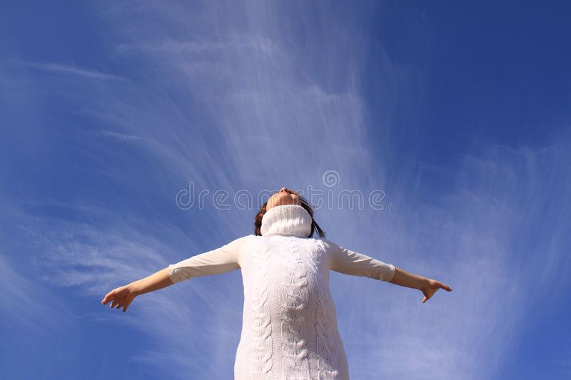 Pregnant happy girl. Up hands on a background blue sky royalty free stock photo