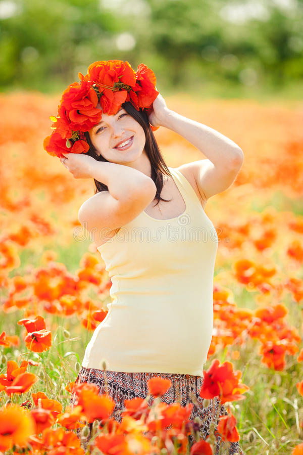 Download Pregnant Happy Woman In A Flowering Poppy Field Outdoors Stock Photo - Image: 36110974