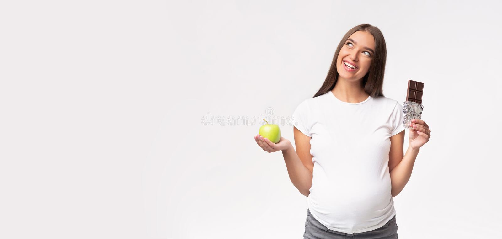 Pregnant Lady Holding Apple And Chocolate Over Gray Background, Panorama stock images