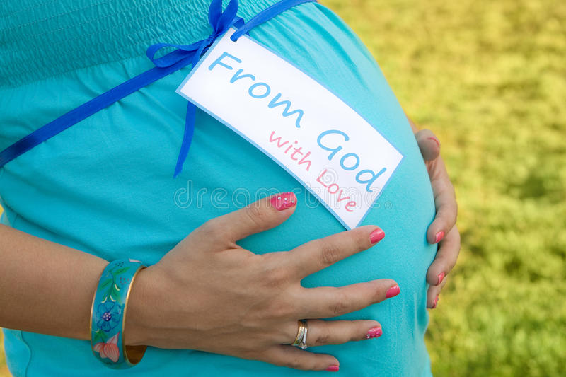 Pregnant Mom Holding Tummy
