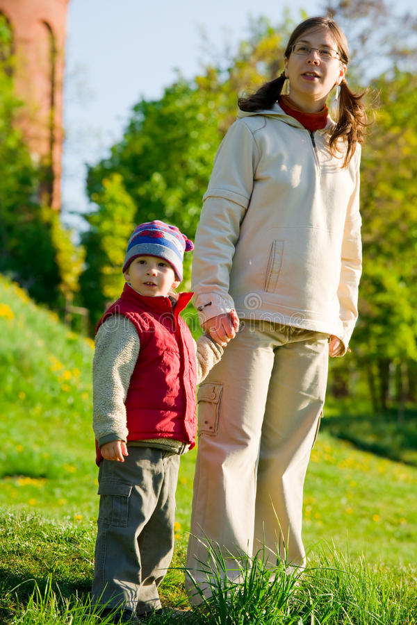 Pregnant mom with son at spring walk royalty free stock photo