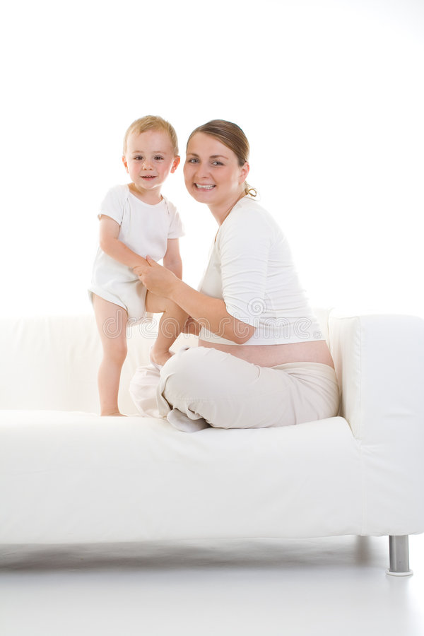 Pregnant mother and child stock photography