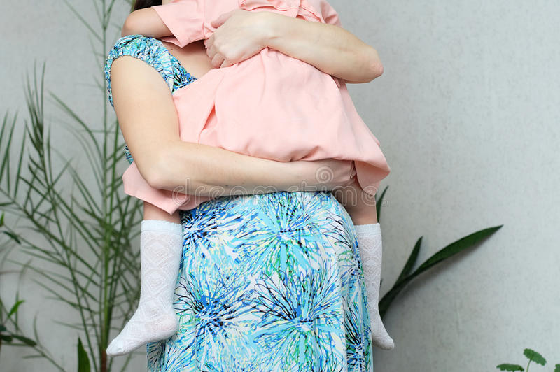 Pregnant mother with daughter, pregnancy belly of woman with child. Happy motherhood. Expecting baby birth in third trimester stock photography