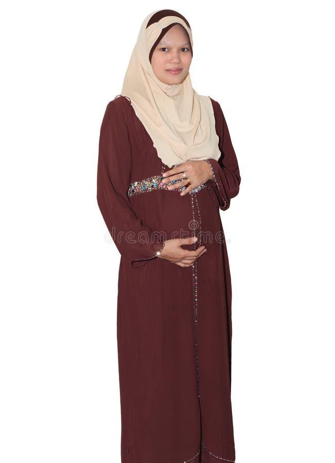 Pregnant muslimah stock photo